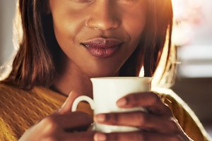 Attractive woman enjoying an energising coffee