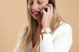 Attractive young blonde woman talking on the phone