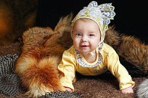 Baby, fox pelt and hauberk