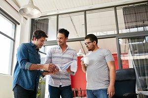 Creative team discussing paperwork