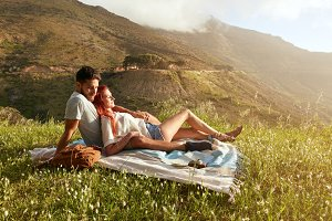 Young couple relaxing on picnic