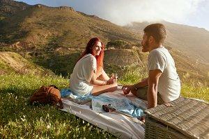 Relaxed couple enjoying picnic