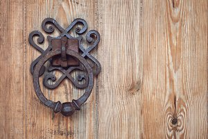 old rusty doorknob and wood door
