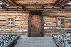 Wooden old door with lock and granite wall