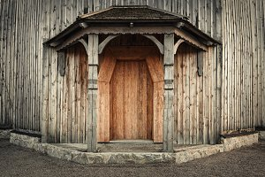 Wooden old door with lock and wall. Background
