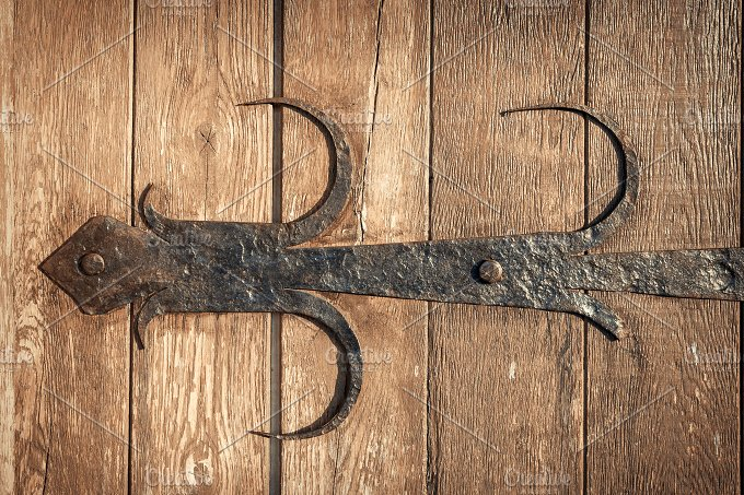 old rusty decorative element and wood door. Background - Architecture