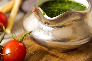 Italian pesto with tomatoes in a gravy boat