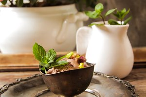 chocolate ice cream with mint in bowl