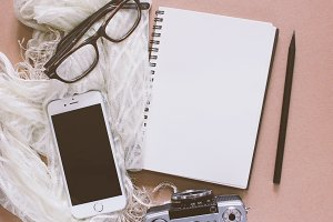 Blank notebook and smartphone