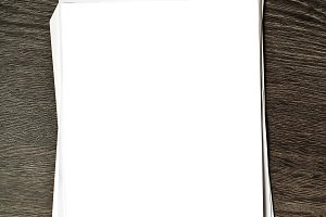 White blank paper on wooden table