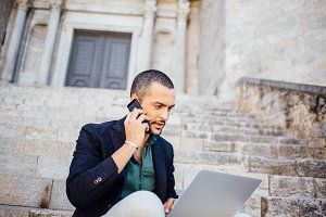 Bearded businessman using phone