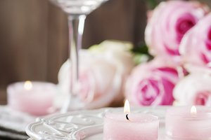 Pink candle and roses