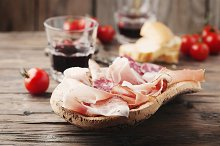 Plate with ham, bacon and salami