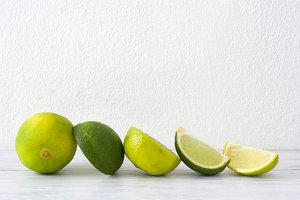 Limes on a white wood table