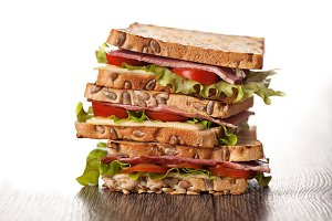 Fresh sandwiches meal on wooden background