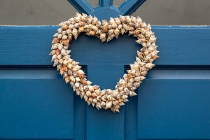 Heart shaped wreath on blue door