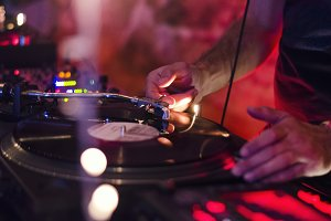 DJ Playing Vinyl Turntable at Party