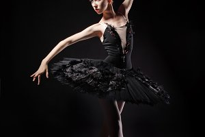 Ballerina in black corset and tutu.
