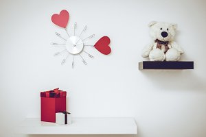 Clock with hearts on the wall