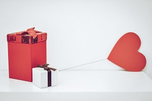 Red gift box and heart on white background