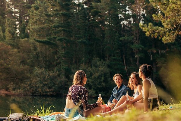 Group of teenagers having a picnic