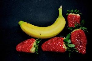 strawberries and banana floating