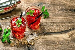 Red cocktail with ice, mint leaves