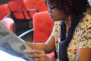 Black Woman Reading A Newspaper