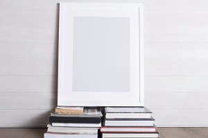 Picture frame sitting on books