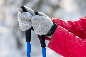 ski poles in women's hands