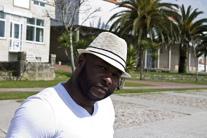 black man with hat