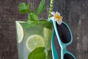 Fresh mojito and summer sunglasses