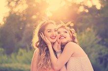 Happy best girlfriends embrace