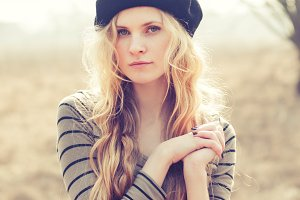 blond girl in a beret