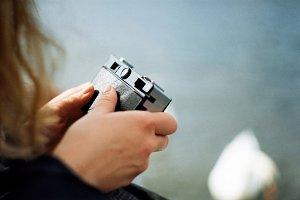 Hands holding a vintage camera