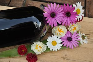 black bottle of wine and flowers