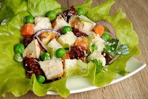portion of salad in lettuce leaves
