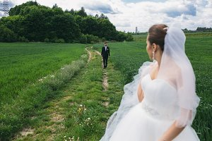 Beautiful wedding couple on nature