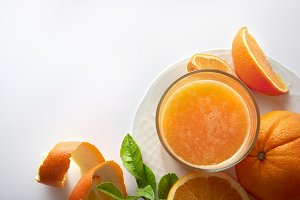 Squeezed orange juice on kitchen top