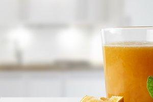Squeezed orange juice on plate