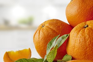 Group of oranges on a plate vertical