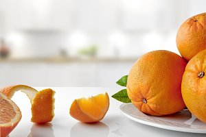 Group of oranges on plate horizontal