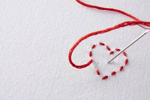 Embroidered red heart close up