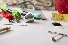 tools for embroidery on white fabric