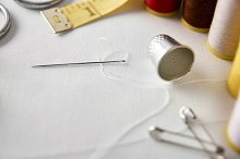 Sewing tools background elevated