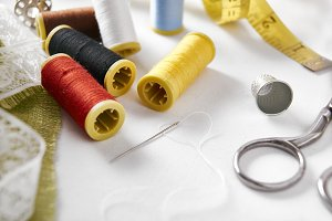 Sewing tools on fabric background