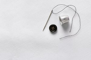 Needle thread thimble and button