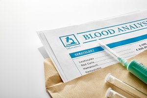 Blood test report in brown envelope