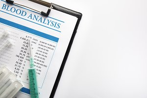 Blood test report in a black folder