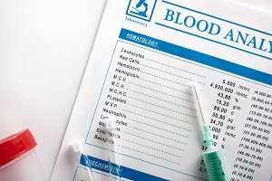Blood test report with syringe top